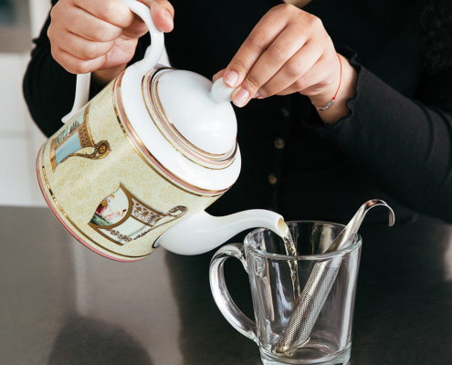 Throwing tea in a cup